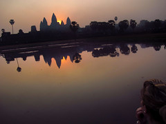 Watching Angkor Sunrise (William J H Leonard) Tags: lake reflection building water architecture sunrise buildings asian temple person ruins asia cambodia southeastasia cambodian candid buddhist ruin buddhism angkorwat siemreap angkor hindu hinduism buddhisttemple hindutemple southeastasian angkorcomplex