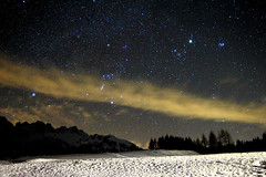 Back to the awe of the starry skies (Robyn Hooz (away)) Tags: trees snow mountains alberi night montagne canon stars eos wideangle neve orion jupiter f28 notte stelle giove 14mm samyang 550d pwwinter