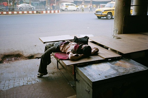 Yet another person asleep in India shot.