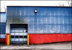 Commercial Barn  -- Albany, NY (greenthumb_38) Tags: door blue red newyork building yellow barn industrial garage commercial albany barndoor blueandred metalbuilding metalsiding jeffreybass