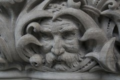 Caught in concrete (Getting Better Shots) Tags: sculpture building face concrete clickcamera