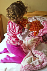 I woke! Start games in sunny morning  IMG_7762-1 (Bobiwankanobi) Tags: life morning baby sunlight playing childhood horizontal toys daylight bed bedroom sunny pillow indoors bulgaria babygirl blanket littlegirl wakeup curlyhair pantyhose domesticlife brittle colorimage 1224months