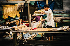 Spreading out the Fish (candersonclick) Tags: china vacation hongkong asia honeymoon lily streetphotography kowloon fishingvillage 2012 lantauisland lantau taio nikond600 tankavillage