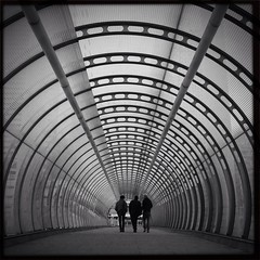 Let's Get Lost (Mark T Simmons) Tags: cameraphone city urban blackandwhite bw london poplar tube tunnel noflash squareformat londonunderground dlr eastlondon iphone flickrapp mobilephotography flickrforiphone iphoneography hipstamatic blackeyssupergrainfilm jamesmlens