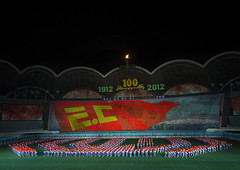Arirang Mass Game In May Day Stadium, Pyongyang, North Korea (Eric Lafforgue) Tags: show people color colour horizontal night asian creativity outdoors photography togetherness clothing war asia nightshot outdoor stadium propaganda mosaic flag politics capital performance panoramic celebration event mass mayday multicolored awe performer stade northkorea traditionalculture skill axisofevil pyongyang dictatorship occupation dprk stalinist traditionalclothing arirang capitalcities choregraphy traveldestinations colorimage teamevent traditionalfestival northkorean koreanlanguage highangleview traveldestination stagecostume democraticpeoplesrepublicofkorea artscultureandentertainment massgames celebrationevent peopleinarow unrecognizableperson maydaystadium dpkr performingartsevent koreanscript massgame rungrado massmouvement largegoupofpeople eti2063