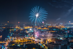 Bangkok Celebration (Weerakarn) Tags: city red river landscape thailand twilight cityscape nightscape bangkok firework celebration nightscene chaophrayariver rattanakosin rattanakosinisland