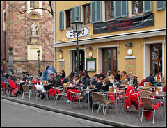 Put a blanket on your knees when it's too cold (pergi28) Tags: city people students caf easter freiburg