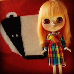 my blythe simply mango, lassi, in a lila marine dress. badger cushion from donna wilson.