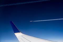 United Together (Mista Sparkle) Tags: sky black altitude united flight wing cruising airline conference contrails 737 wingtip aileron 1000mph 37000feet