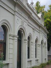 The Former Alexandra Mechanics Institute and Free Library  Corner Grant and Perkins Streets, Alexandra (raaen99) Tags: building heritage urn architecture town education pattern architecturaldetail library painted pillar 19thcentury decoration victorian australia victoria institute alexandra victoriana historical column stucco grantstreet 1877 publiclibrary parapet nineteenthcentury 1890s 1892 1883 classicalarchitecture 1870s 1880s countryvictoria grantst mechanicsinstitute adulteducation heritagelisted countrytown billiardhall architecturalfeature northeastvictoria freepubliclibrary architectunknown provincialvictoria perkinsstreet educationalestablishment victorianfreeclassical stuccoedbrick technicalinstitution victorianfreeclassicalbuilding victorianfreeclassicalarchitecture billardsaloon alexandramechanicsinstitute alexandramechanicsinstituteandfreelibrary alexandrafreelibrary alexandrafreepubliclibrary clasicalbuilding