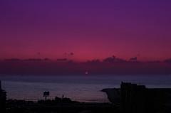 Sunset (vartkesn) Tags: light sunset sea cloud sun building water ripple wave blinkagain