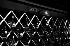 Tasting Bar (chrisroach) Tags: kelowna wine missionhill winery bw blackandwhite blackwhite monochrome tastingbar winetasting rack winecountry bc britishcolumbia