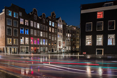 Colour Flash (McQuaide Photography) Tags: amsterdam noordholland northholland netherlands nederland holland dutch europe sony a7rii ilce7rm2 alpha mirrorless 1635mm sonyzeiss zeiss variotessar fullframe mcquaidephotography adobe photoshop lightroom tripod manfrotto light licht night nacht nightphotography longexposure stad city capitalcity urban lowlight architecture outdoor outside old oud gracht grachtenpand canalhouse house huis huizen traditional authentic water reflection centrum gebouw building waterfront waterside canal colour colours color redlight redlightdistrict windows tourism touristattraction travel rld motion movement dynamic lighttrail wideangle wideanglelens groothoek
