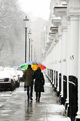 Colourful umbrella in the snow (5ERG10) Tags: street uk houses winter england white snow colour london colors sergio umbrella walking couple europe chelsea place pavement perspective january row pop neve coloring kensington lamps colourful colouring selective 2013 amiti 5erg10