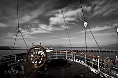At the helm (Kevin English Photography) Tags: ocean wood old travel sea sky brown white black color wheel vintage handle gold boat wooden sailing ship control yacht guidance antique transport vessel deck direction journey maritime pirate transportation captain sail leader tall ropes nautical steer brass leadership navigation helm oldfashioned selective