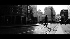untitled (Lszl_F) Tags: street city shadow people blackandwhite bw cinema film amsterdam movie person blackwhite fuji widescreen streetphotography flare rails fujifilm backlit cinematic 219 x10 koningsplein cinematicphotography fujifilmx10 fujix10