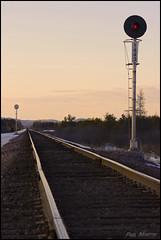 Searchlight Sunset (Philip_Martin) Tags: railroad sunset chicago black wisconsin train river adams pacific general sub union north railway falls line western searchlight sa signal wi sa1 brockway altoona subdivision cnw