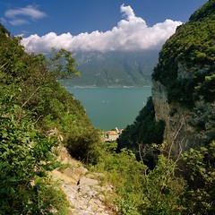 Spectacular hiking path Prabione to Campione (Bn) Tags: blue summer vacation sky italy mountain lake holiday alps colour green nature water sport del clouds forest trekking walking landscape fun lago coast canal carved garda rocks mediterranean italia sailing terrace hiking path air deep rocky tunnel panoramic via mount explore trail step alpine valley caution ravine gorge fjord pastures climber shape overlooking majestic bushes topf100 shrubs climate gardameer bassa campione baldo 100faves 4hr nr266 nr267 prapione 2218m afvanture