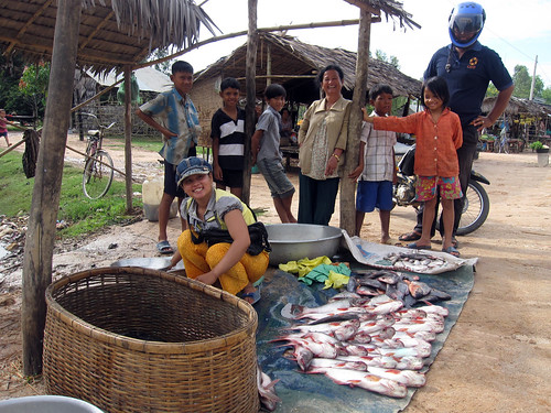 A fish seller selling Pangasius fish   in local market in rural Cambodia. Photo by Jharendu Pant, 2009.