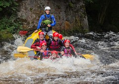 Loving His Job (Chris Willis 10) Tags: white water rafting bala wales river people faces funny wet