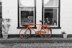 orange bike (inigo.landa) Tags: orange bike black white selective desaturation netherlands texel old