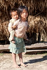 Children in poverty (Oakseed) Tags: asia boy brother care caring carry carrying child children cohesion dirty ethnic family girl kid laos life neglected people pickaback piggyback poor portrait poverty sad sister social unhygienically young