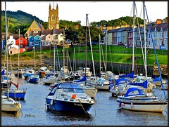 village harbour Aberaeron (jeansmachines24) Tags: aberaeron ceredigion cardiganshire harbour colourful boats tidal church colourfullypaintedhouses terraced masts tidecomingin eveninglight summer2016