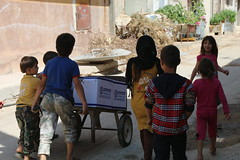 Children in in bombed-out Aleppo receive food relief (Ummah Welfare Trust) Tags: syria levant war poverty hunger children middle east        humanitarian humanitarianism islam muslims