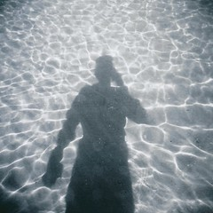 Portrait of the artist with wet feet - lomo (sonofwalrus) Tags: ocean africa light shadow sea selfportrait film beach water holga lomo lomography sand patterns redsea egypt middleeast scan refraction ripples مصر hpc5380