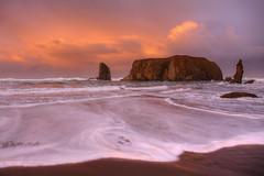 Oregon Coast Sunrise (jeremyjonkman) Tags: ocean sunset cloud beach rock clouds oregon sunrise canon photography eos sand mark sandy rocky jeremy ii haystack 5d bandon jonkman