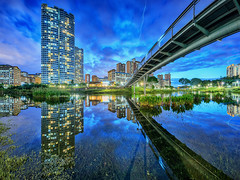 Public Housing Paradise (Scintt) Tags: park city bridge blue homes sunset sky panorama reflection public water skyline architecture clouds buildings river garden mirror evening stream long exposure cityscape slow skyscrapers towers structures dramatic surreal mo flats condo hour shutter housing ang hdb stitched estates kio bishan singaore scintillation scintt