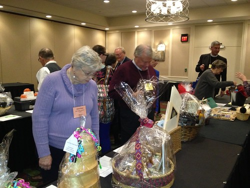 "<p>The silent auction to benefit the Diocesan Youth Commission included a hotly contested ""Justified"" basket from Harlan -- complete with a bottle of moonshine.</p>"