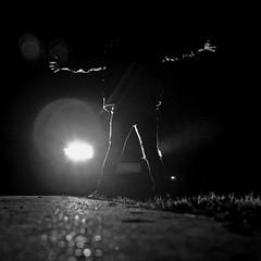 (helle-belle) Tags: portrait bw woman selfportrait me monochrome car night standing evening blackwhite vinter darkness headlights bil lys aften rasteplads 2011 selvportræt sorthvid hellebelle forlygter canoneos5dmrkii