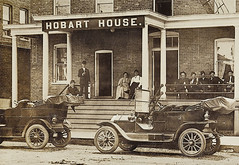 Hobart House, Hobart, Indiana, section 1 (Hoosier Recollections) Tags: people woman usa signs man men history cars sepia buildings advertising clothing women furniture hats indiana transportation porch hotels hobart automobiles banks businesses lakecounty realphoto hoosierrecollections