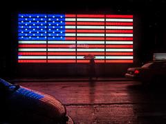 welcome to america // new york, usa (pamela ross) Tags: newyork usa america flag states united lights shilouette street olympus pen epl5 pamelaross photography walking rain umbrella