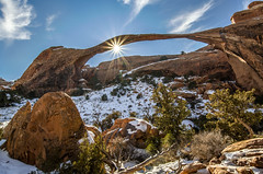 Sunburst at Landscape Arch (Steve Flowers) Tags: winter snow utah moab sunburst archesnationalpark landscapearch nikond7000 nikon1024mmf3545gedafsdx photoclamtripodbh