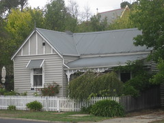 A Late Victorian Weatherboard Villa - Yea (raaen99) Tags: flowers windows chimney house flower building tree home window leaves rose architecture facade fence garden awning tin town iron suburban timber 19thcentury decoration victorian entrance australia victoria artnouveau porch woodenfence villa verandah nouveau residence whitepicketfence yea agapanthus roofline shrubs tinroof gable corrugatediron weatherboard portico pickets nineteenthcentury picketfence 1890s fretwork 1880s sashwindow countryvictoria vestibule domesticarchitecture lacework countrytown architecturalfeature bullnoseverandah pailings provincialvictoria victoriania tinverandah notheastvictoria