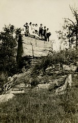 A Small Crowd on a Big Rock (Alan Mays) Tags: old trees girls cute men boys portraits vintage children women funny rocks humorous photos antique humor hats ephemera hills photographs postcards amusing groups rockformations foundphotos hillsides rppc realphotopostcards