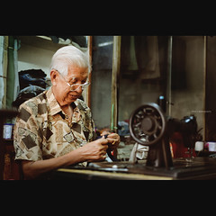 the old tailor of Pasir Puteh (Chez C.) Tags: street old light shadow portrait man candid elderly getty moment vignetting tailor gettyimages pasirputeh