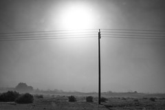 Dust Storm (joshuammulligan) Tags: california blackandwhite bw strange landscape desert wind empty dunes dune dirt valley sandstorm bleak coachella haunting powerline duststorm telephonepole indio blowingsand