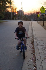 Cruising on Bike (spinadelic) Tags: bear street boy sunset portrait signs bike bicycle sign rock kids warning children march spring ride little dusk pavement helmet tshirt safety neighborhood sidewalk stop arkansas polar asphalt stevespencer 2013