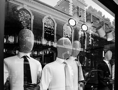 Chequered heads (Istvn Mez) Tags: shop window