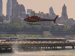 Helicopter At Downtown Heliport (nrhodesphotos(the_eye_of_the_moment)) Tags: dsc05004160 theeyeofthemoment21gmailcom wwwflickrcomphotostheeyeofthemoment helicopter helipad brooklyn waterfront manhattan nyc wallstreet downtownhelipad architecture flyingmachine outdoor eastriver trees cars perspective transportation season summertime brooklynheights metal glass boat shadows reflections