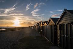(NVOXVII) Tags: beachhuts sunset dusk sky clouds outdoor leadinglines composition soulful arty nikon beach coast lowlight hampshire contrast lightflare lensflare