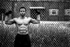 Martel IV (giladvalkor) Tags: man people guy fence gritty blackandwhite black muscles fitness flexing shirtless abs physique body