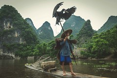Cormorant... (Syahrel Azha Hashim) Tags: nikon unique tokina shallow holiday chinese xingping ultrawideangle bird traditional dof bokeh bamboo conventional getaway handheld vacation china light naturallight 16mm colorful guilin d300s travel syahrel single detail elder uwa bambooraft cormorants oldman fisherman