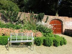 A joyful bench (Explored) (JulieK (finally moved to Wexford)) Tags: inexplore hbm bench benchmonday colcloughwalledgarden wall touristattraction wexford tinternabbey flowerbed sedum autumnjoy door blooms