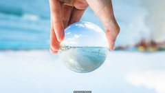 Sea sphere (Nicola Pezzoli) Tags: glass crystal sphere upside down cinta san teodoro olbia sardegna nature landscape bokeh beach hand colors waves blue sky clouds canon