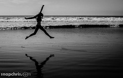 Black and White silhouette and reflection of a beautiful young girl running at the beach (tibchris) Tags: california playing reflection beach water girl silhouette fun happy dance waves chica happiness running teen blonde belle bella superbowl stinsonbeach hermosa shayna fille mdchen ragazza  schne pige    smuk   snapchris