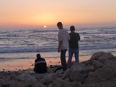 Fishing on the Bat Yam beach (dlisbona) Tags: sunset sea vacation mer holiday beach vacances soleil israel telaviv seaside sonnenuntergang  coucherdusoleil batyam